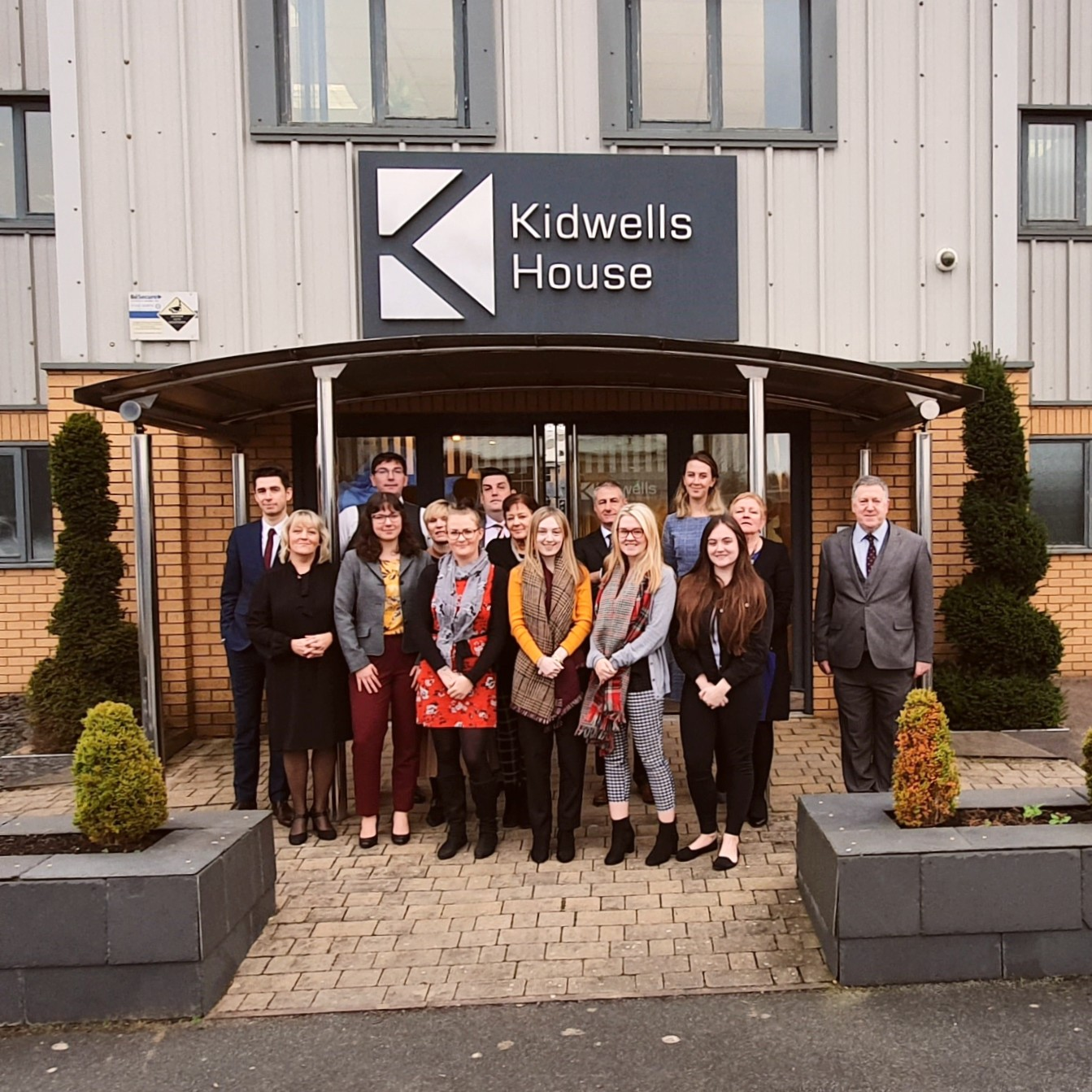 The Kidwells team brings in the New Year and new decade at the Kidwells office.